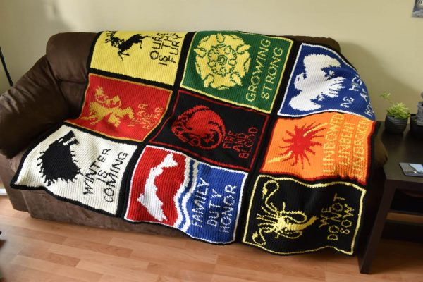 crochet game of thrones sigil blanket displayed on a couch