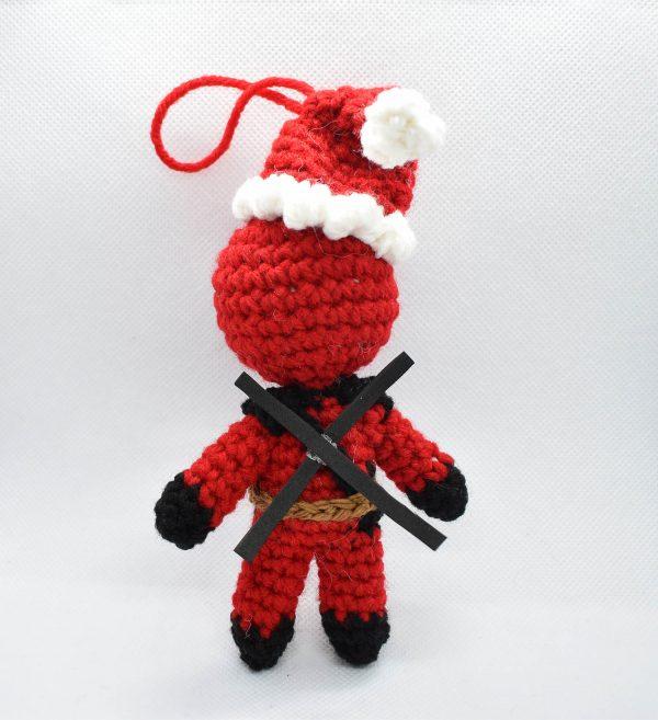 back view of crochet ornament of deadpool wearing a santa hat