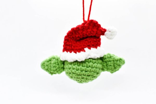 back view of crochet christmas ornament of yoda wearing a santa hat