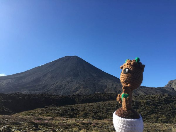 baby groot crochet doll in front of mt. nguarahoe in new zealand