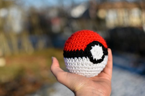 pokeball amigurumi toy held in my hand