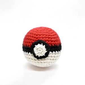 pokeball amigurumi toy against a white background