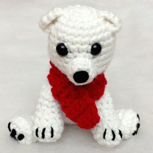 crochet polar bear wearing a red scarf