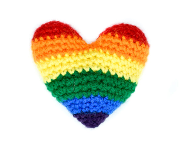 crochet heart in the rainbow colours of the gay pride flag