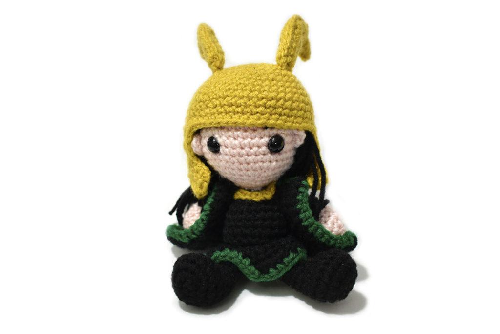 crochet Loki doll against a white background