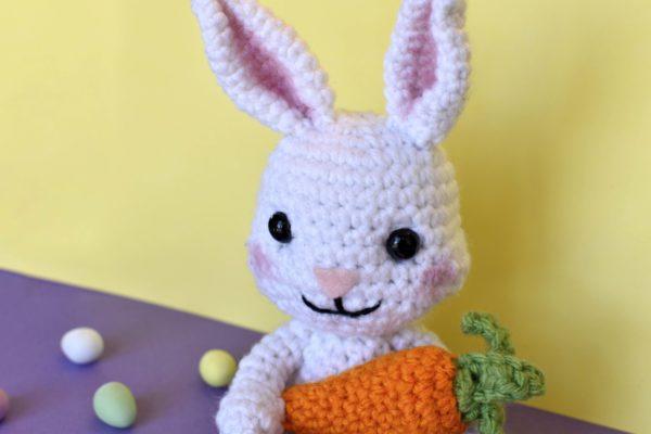 close up of crochet bunny rabbit holding a crochet carrot