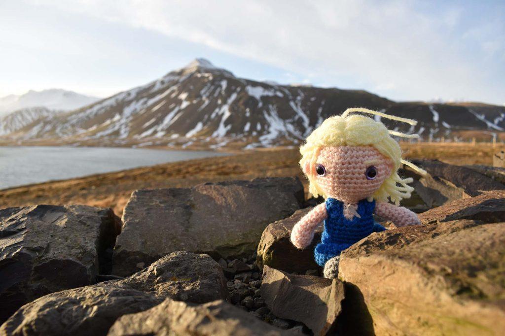 crochet Daenerys doll in front of a mountain landscape in Iceland