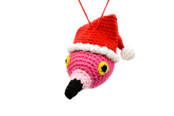 image of a hanging ornament crochet flamingo head wearing a Santa hat