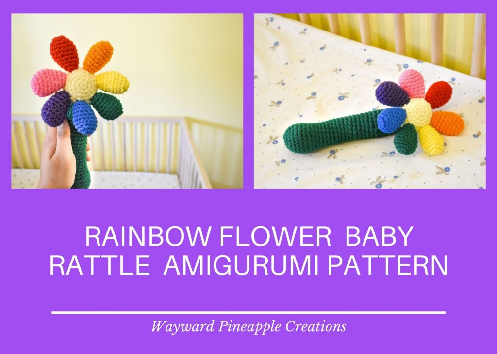text: rainbow flower baby rattle amigurumi pattern by Wayward Pineapple Creations. The text is on a purple background below two photos of a crochet baby rattle shaped like a flower with rainbow coloured petals.