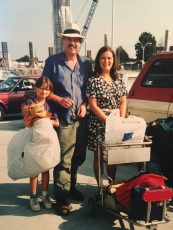 Me at 9 years old with my big stuffed Simba, on the way back from a family trip around Europe